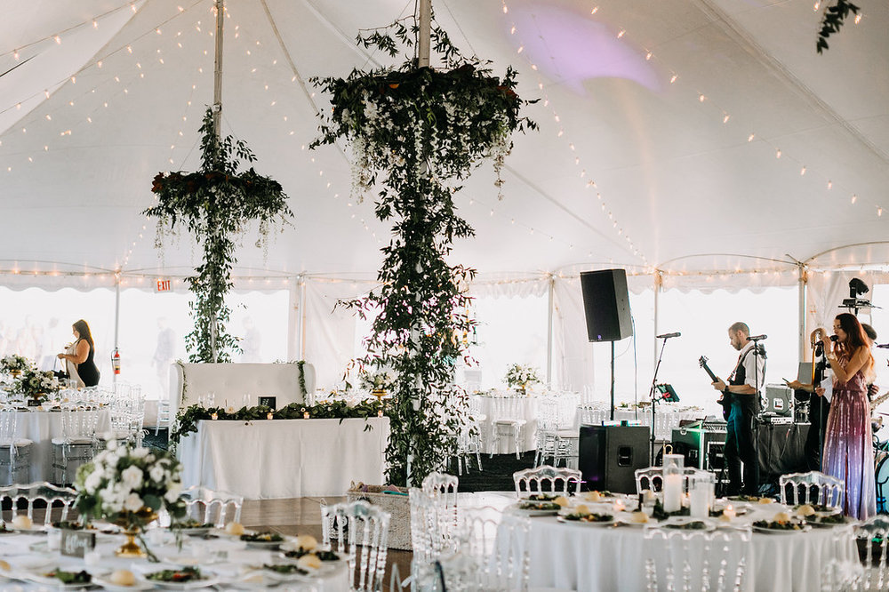 Floral chandeliers, smilax on tent poles, tent wedding, beach wedding, Love Me Do Photography, NJ wedding
