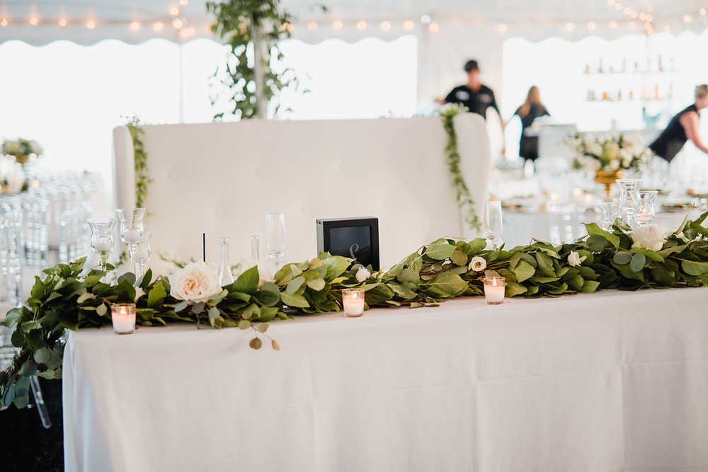 sweetheart table with bench, garland on sweetheart table, tent wedding, Love Me Do Photography