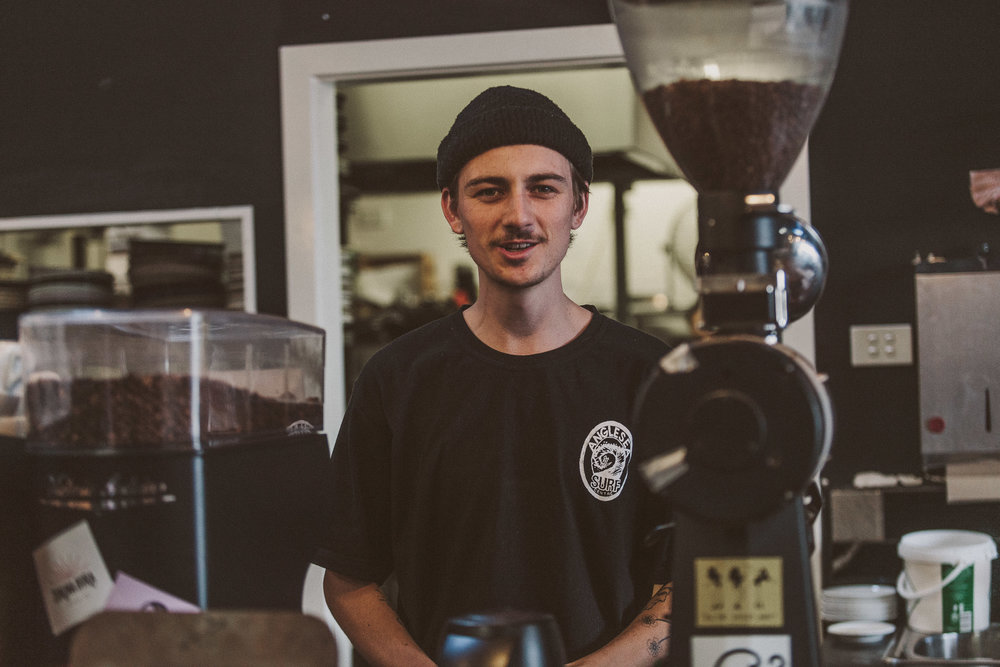 Tristan River - Rumour has it that Trizz was making espresso before he could talk. Now he does both frequently and with incredible ease. You'll find him training up our wholesale partners to brew the best coffee in the universe or delivering our freshly roasted beans all over the country.When he's not winning barista competitions you'll find him listening to MF Doom and working in his garden.