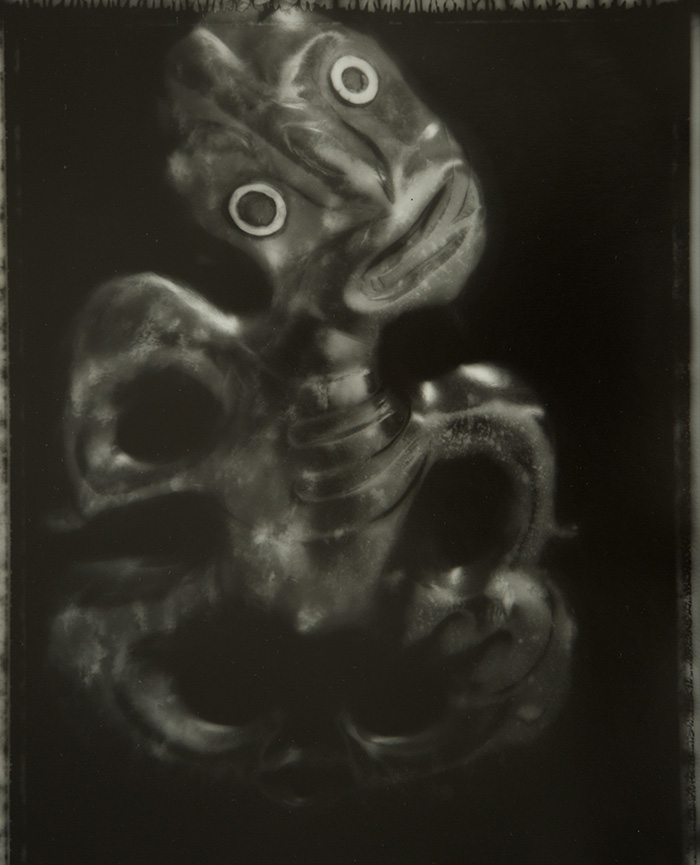 Fiona Pardington  Taranaki Style with Paua Eyes Heitiki From The Burnett Collection Whanganui Museum , 2008 Toned silver bromide fibre based print 600 x 500 mm [Private Collection]  _______
