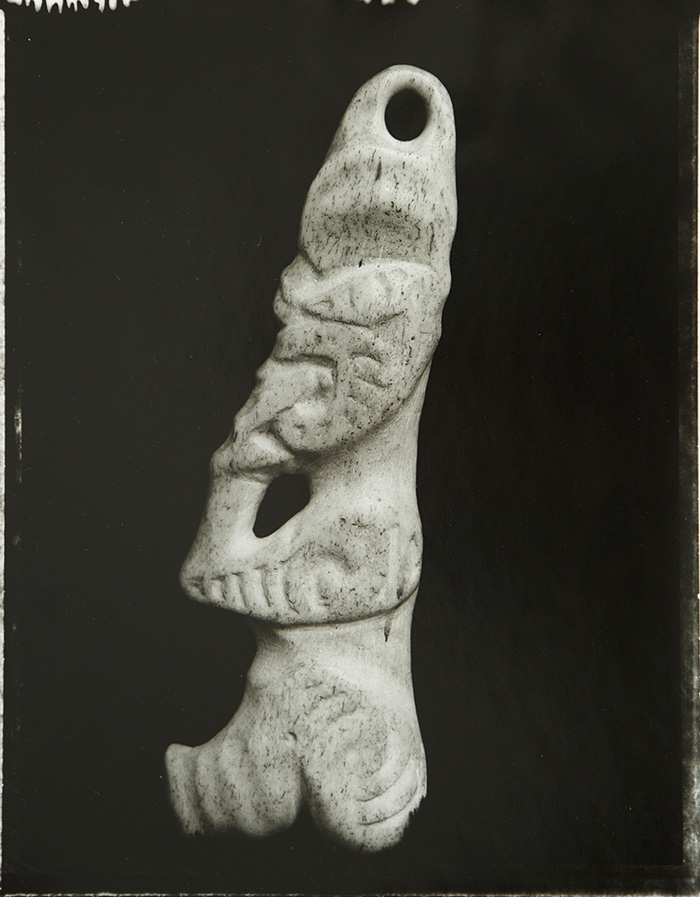 Fiona Pardington  Tiki in profile in human bone, provenance unknown, Okains Bay Maori and Colonial Museum , 2002 Framed toned silver bromide fibre based print 600 x 500 mm (image size) $8,500 incl. GST Edition of 5  _______