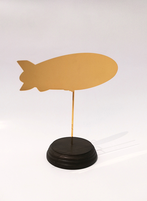 Wayne Youle  Objects for making one feel better, worse or indifferent (Zeppelin),  2017 18ct hard gold plated stainless steel on waxed Rimu base $1,000 incl. GST  _______