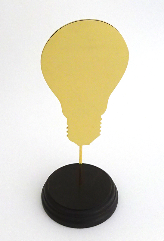 Wayne Youle  Objects for making one feel better, worse or indifferent (bulb),  2017 18ct hard gold plated stainless steel on waxed Rimu base $1,000 incl. GST  _______