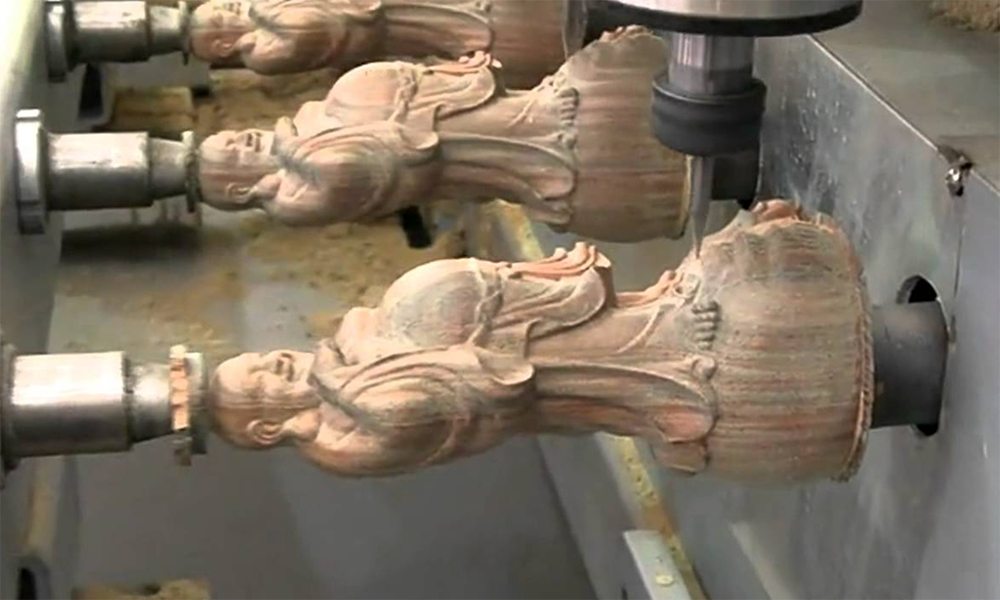 Fig. 4 Multiple identical Buddha figures manufactured through CNC machinery.