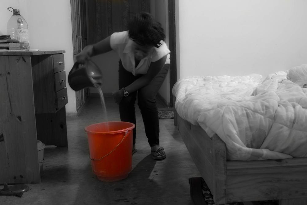 Me preparing for a bucket bath