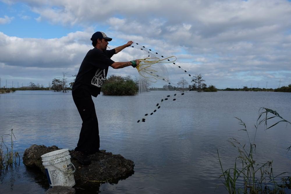 Cast net shrimper, Venice, Louisiana.November 3, 2015.