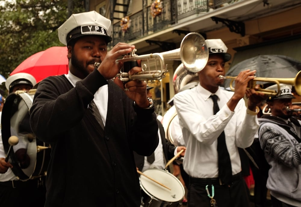 Jazz musicians follow wedding party, Royal Street, French Quarter. November 21, 2015.