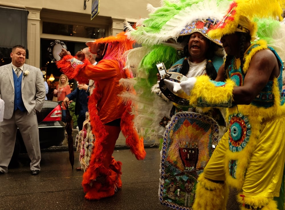 Mardi Gras Indians leading a wedding party, Royal Street, French Quarter. November 21, 2015.
