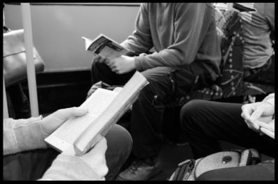 two readers on tram.jpg