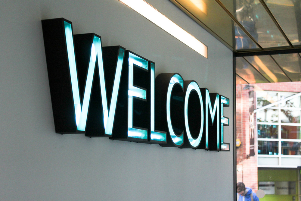 The internal welcome signage was hand made with a slight rust finish. The aqua neon was matched perfectly to the College's brand pallet.