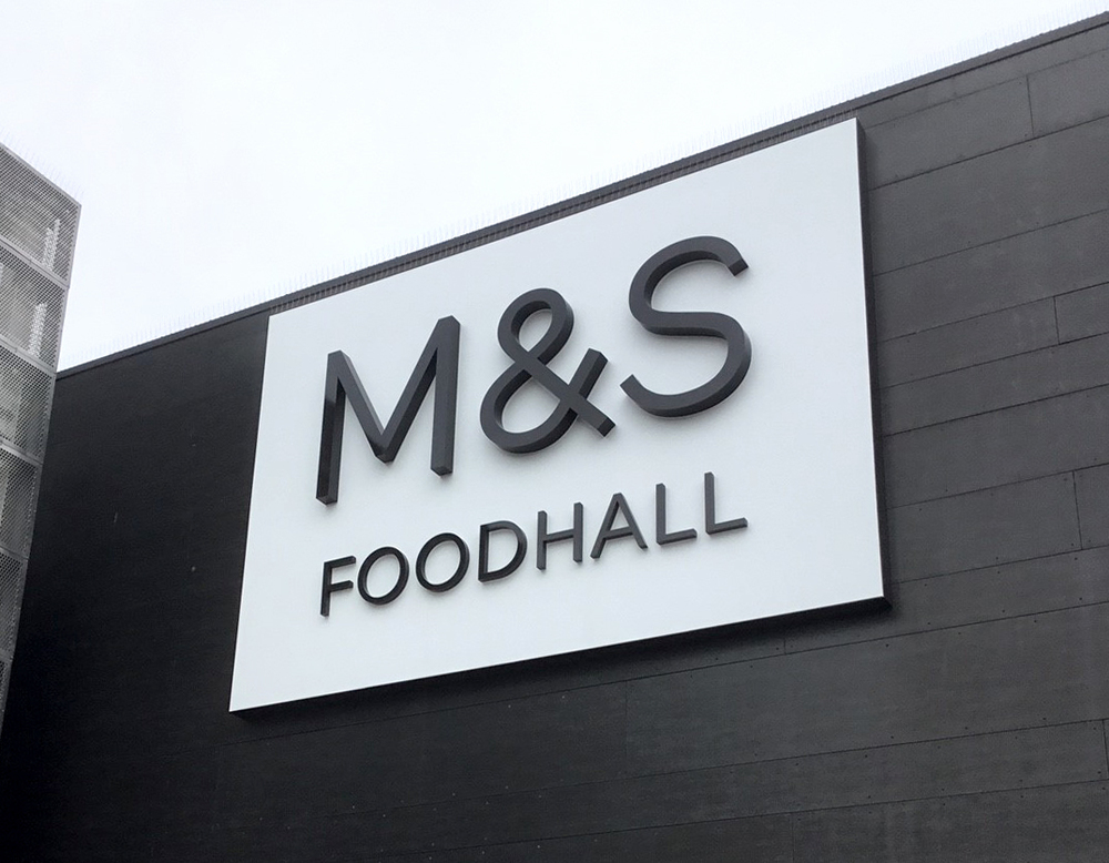 M&S Foodhall branding - the logo is fabricated in stainless steel. Edinburgh, Scotland