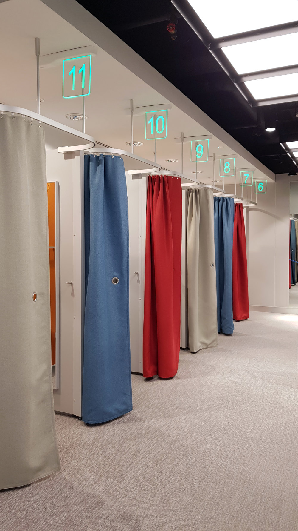 LED illuminated changing room signage, activated by proximity sensor