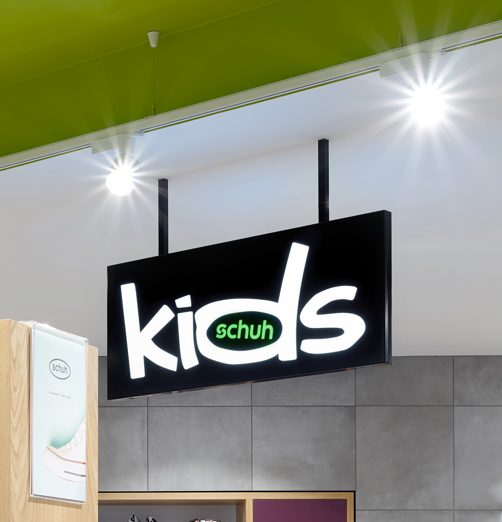 In-store internally illuminated Kids and schuh branding