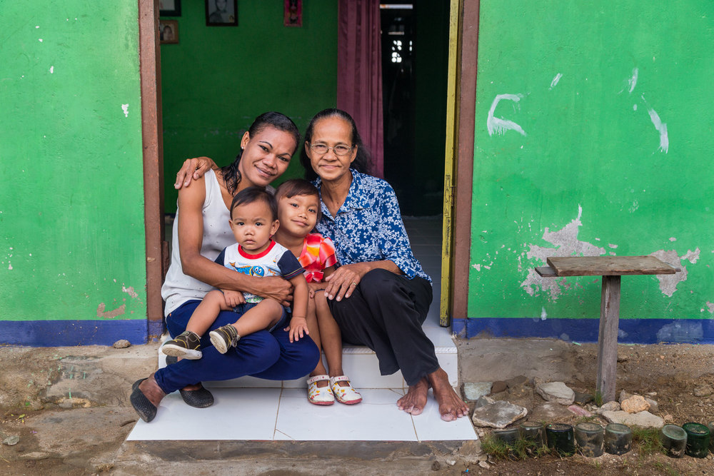 A family portrait of Ibu Siti along with her mother, Young, and Vio.