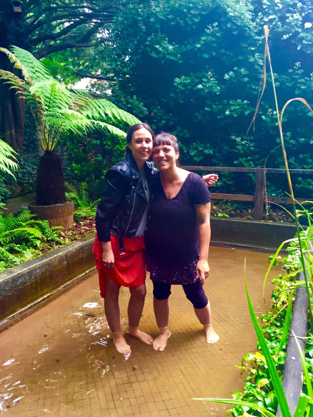 - We met on our Reiki Masters retreat in Glastonbury.  Here we are the day of our Master's attunement grounding in the red spring of the Chalice Well.