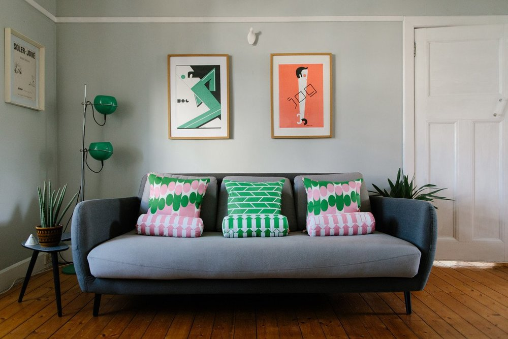 Laura_Spring_Arrow_Boulster_Cushion_pink_Green_sofa_with_Milkky_Convergence_Cushions_credit_Caro_Weiss_2048x2048.jpg