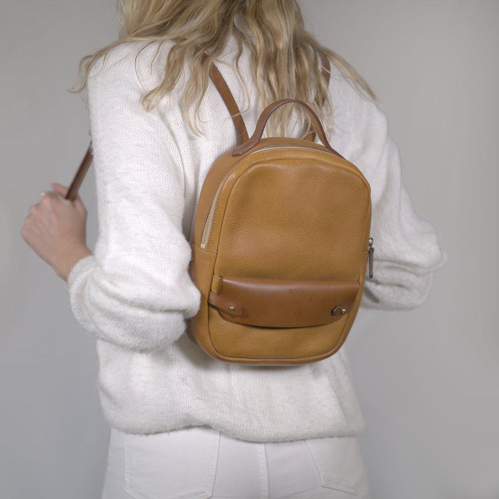 Handmade-leather-day-pack-on-model.jpg
