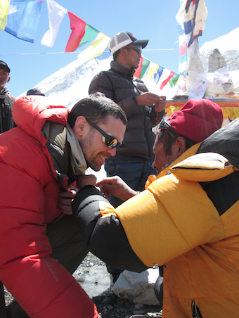 Above: Andrew receiving a sundi necklace for good luck during his puja blessing ceremony at base camp