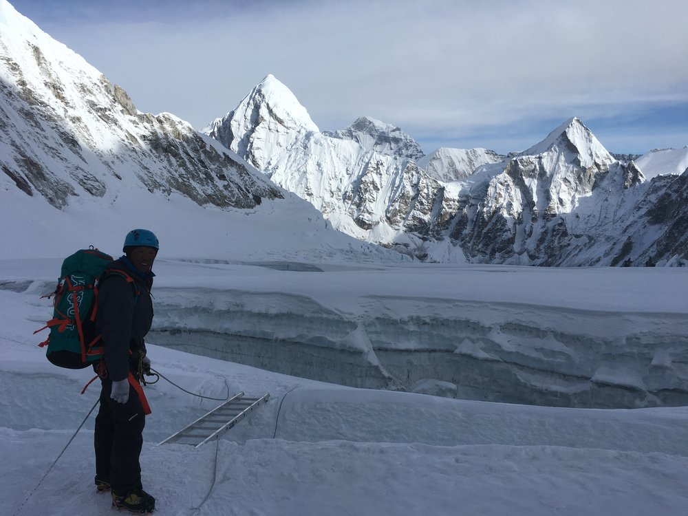Descending the Western Cwm toward Camp 1 with (L to R) Pumo Ri, Cho Oyu, and Lingtren in the back