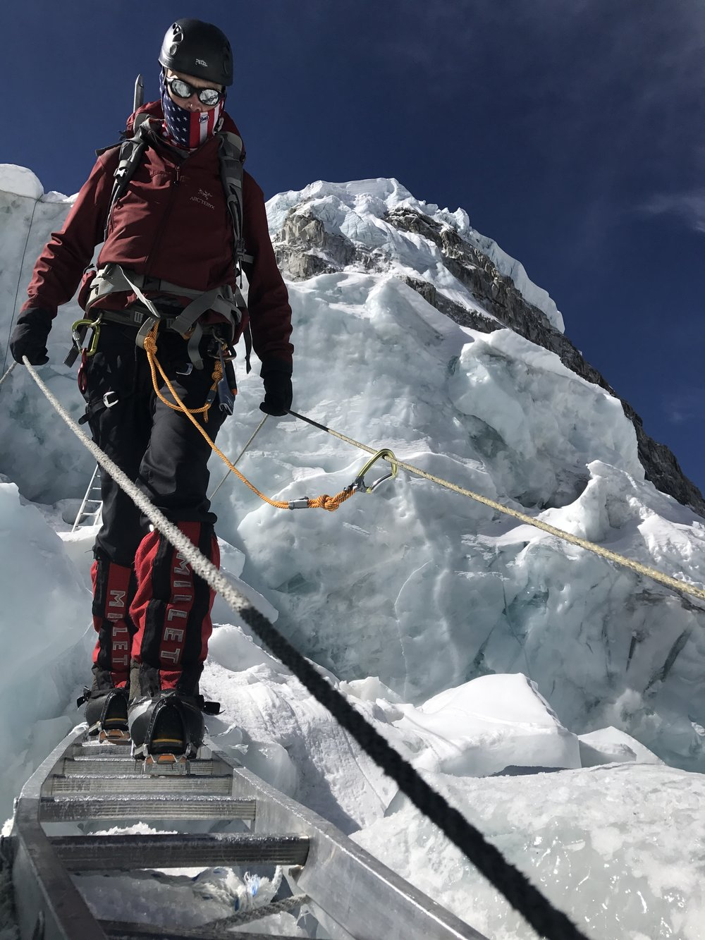 Crossing a crevasse in the Icefall (photo credit Luke Reilly)