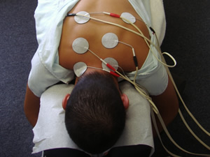 Electric stimulation pads are placed on muscles in spasm.