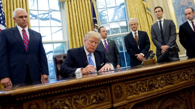 Trump signs the funding ban on international abortion services (source: www.bbc.co.uk)
