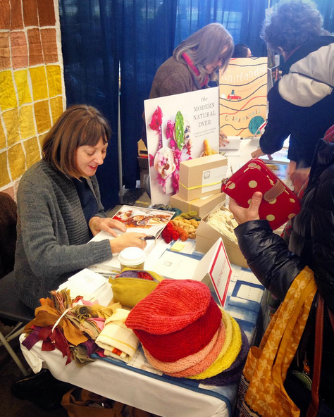 Kristine Vejar signing copies of her book,  The Modern Natural Dyer , for fans at The NYS Sheep & Wool Festival on 10/17/15. Photo credit: Mamie VanLangen