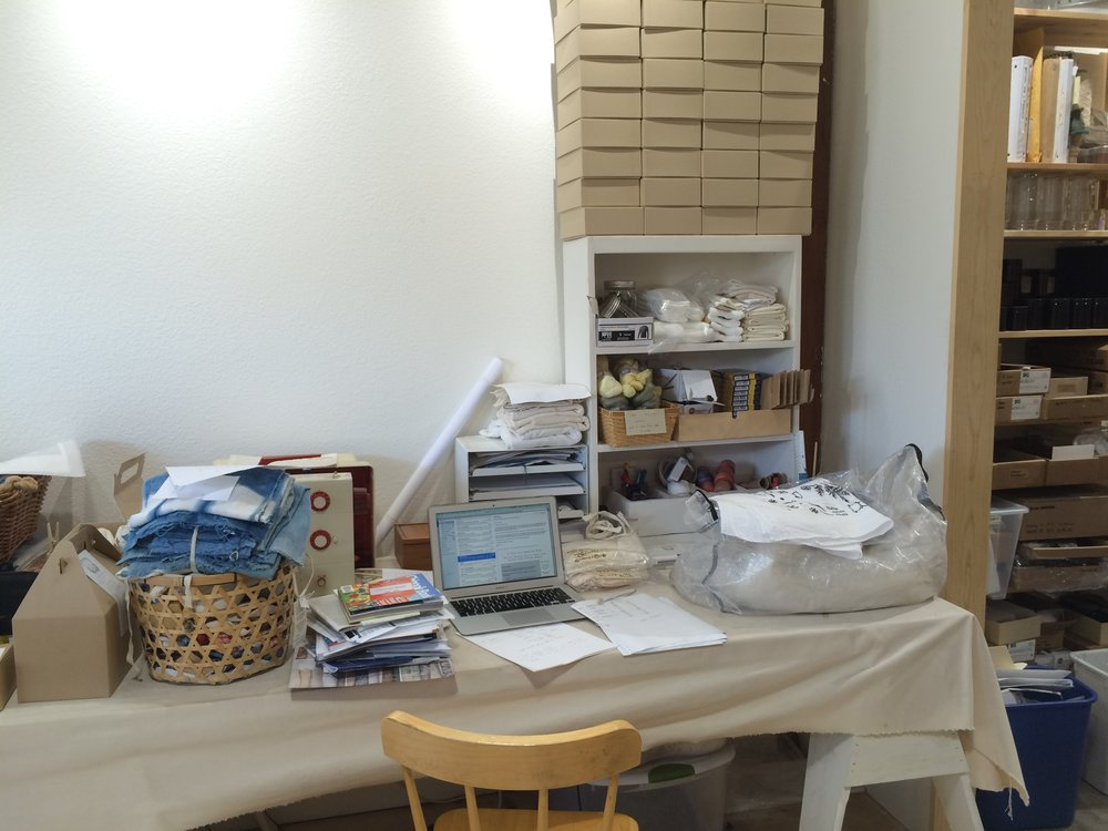 A work station tucked among components for natural dye kits