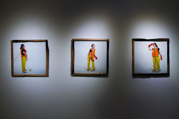 Installation view. 'Artist as Worker'. C-print: Three 50x50cm C-prints framed in crumbling 100 year old dock floor wood. Photo: Hulda Rós Guðnadóttir.