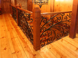 Hartford Residence: For this project, we were awarded the Gold Award for Interior Railings at the 2006 National Ornamental and Miscellaneous Metals Association (NOMMA) Top Job competition. The unique railing was fabricated using no forging techniques. A significant amount of time was spent creating the shop drawings in CAD. Laying out the scrolls to fit the geometry of the stair configuration proved to be quite a challenge. The CAD file was then used for the CNC machine and the decorative panels were burned out of a flat sheet of 5/8 inch steel plate. After the panels were cut vines were woven through the pattern and individual leaves of varying shapes and sizes were welded into place. The railings were then powder coated black.