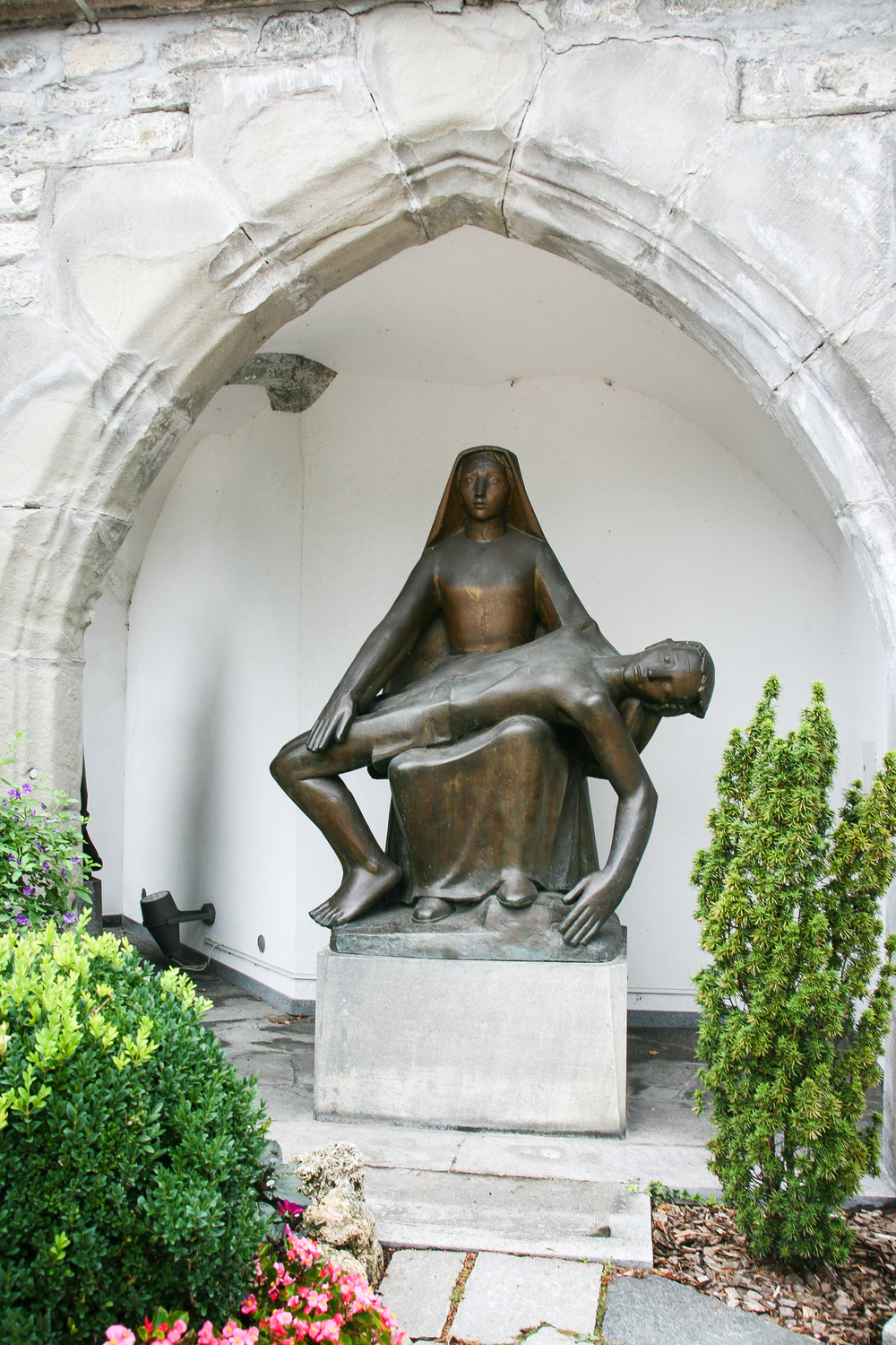 Vaduz.  St. Florin Cathedral, church art in the yard.