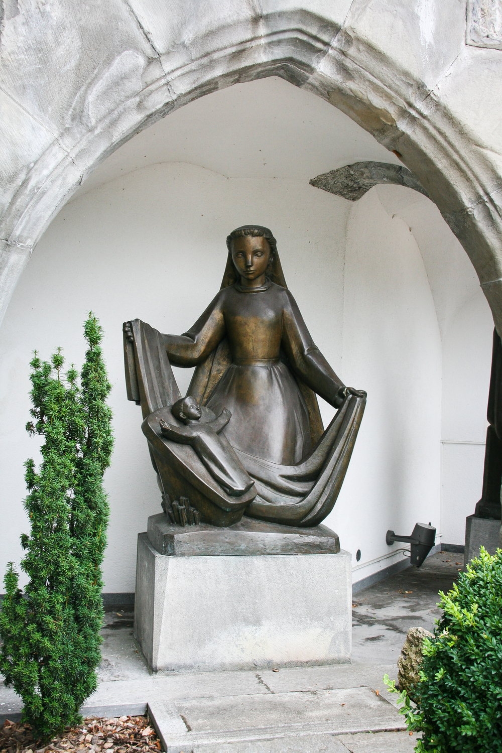 Vaduz.  St. Florin Cathedral, church art in the yard, part 2.