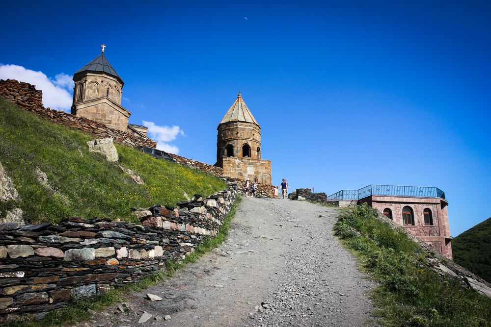 Kazbegi . Gergeti Trinity Church. The last few hundred meters need to be walked up...
