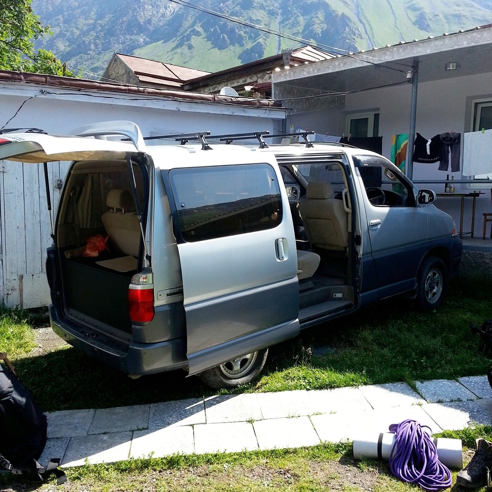 Kazbegi . Preprarations for the return to Tbilisi. This van will be transporting 8 people with their luggage.