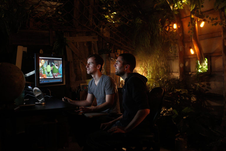Animators are encouraged to get creative with their office space. These two created a jungle theme.