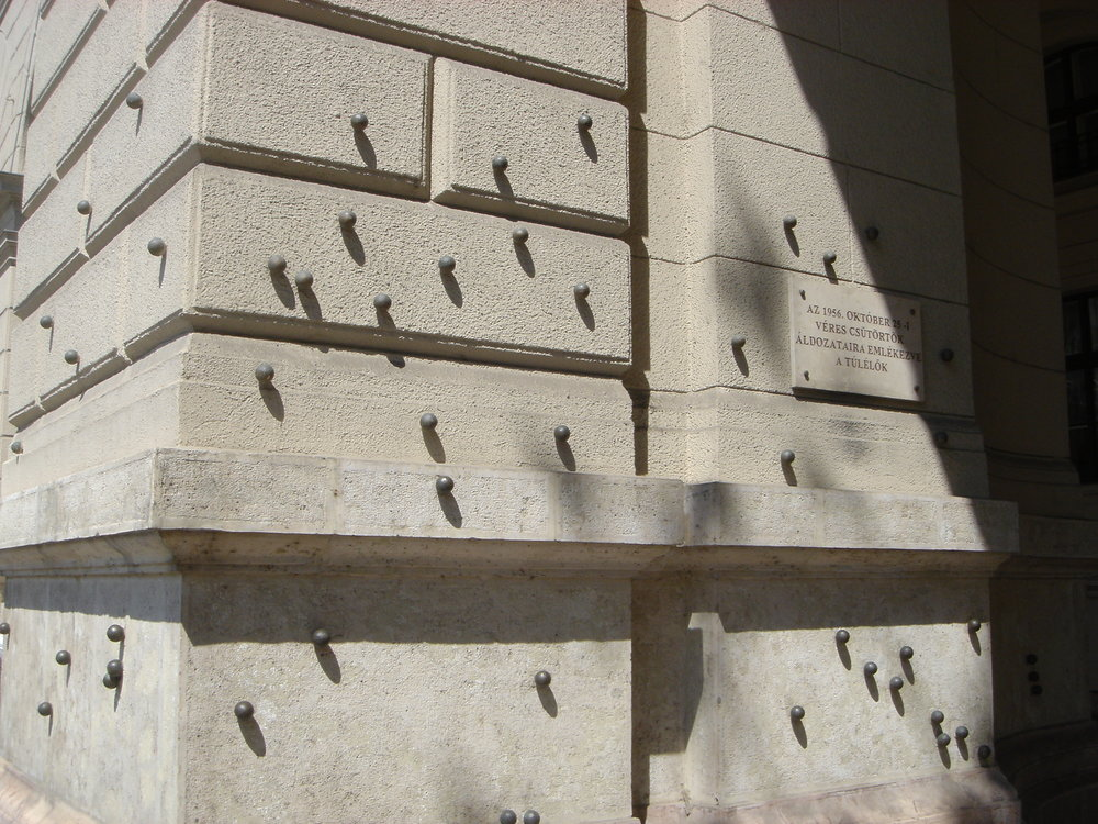 Metal Pellets Marking Bullet Holes from 1956 Revolution on Kossuth Lajos Square Close to the Hungarian Parliament Building