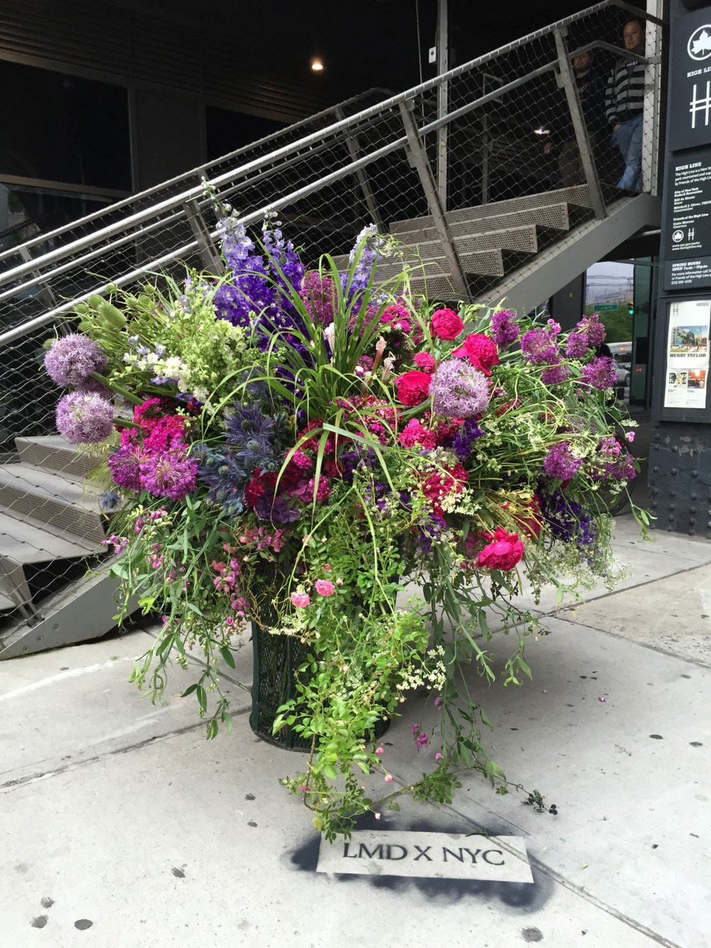 A recent Lewis Miller Flower Flash project was a trash bin at the base of the Highline in the Meatpacking District. Miller leaves his initials in chalk to mark the spot.