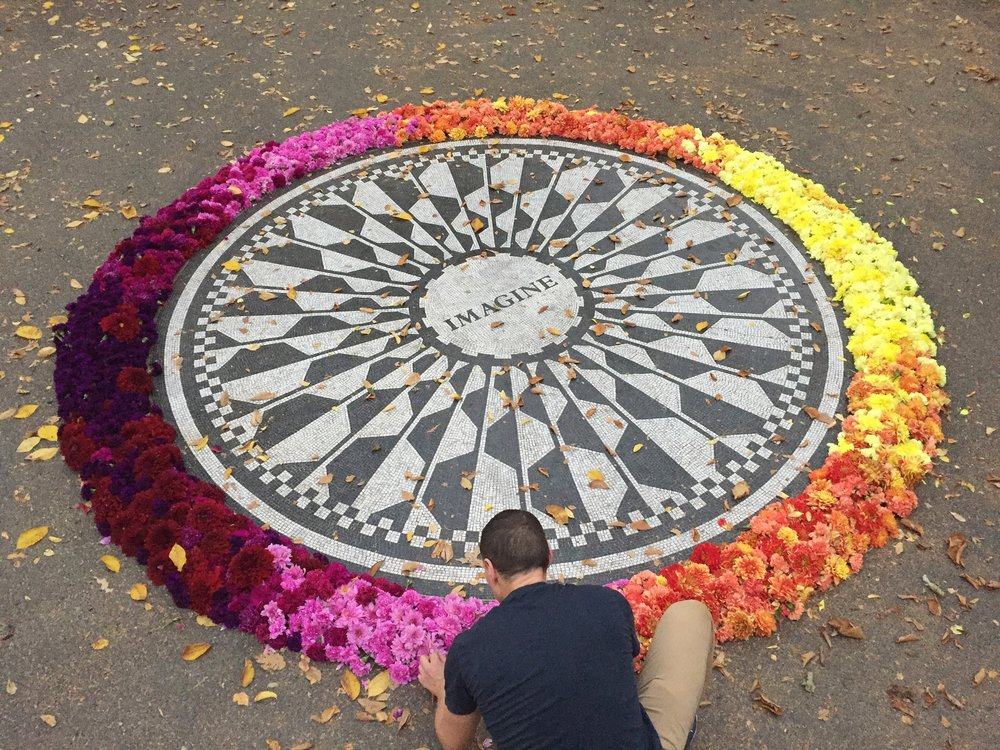 John Lennon Memorial in Central Park: a circular mosaic resembling a mandala with one word in the center: IMAGINE.