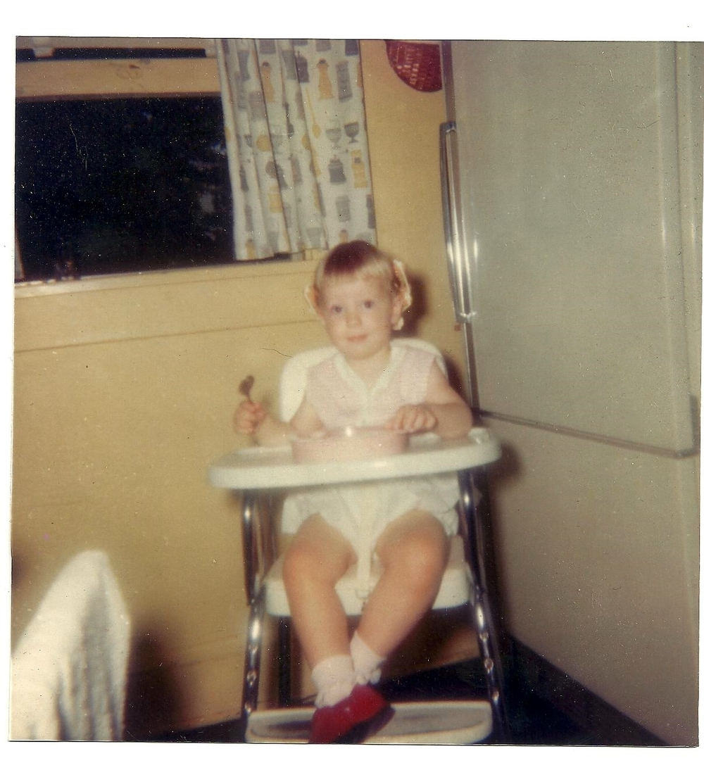 Young Carol, enthusiastic eater and lover of red shoes. Photo credit: Mama