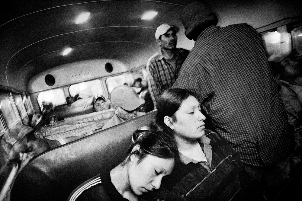 Riding to work in a farm labor bus. Fresno, California. 2004.  Inquire about this image