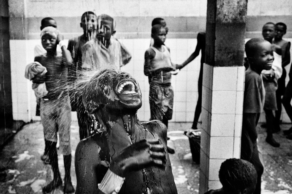 Children at a centre for street kids in Kinshasa. Many children are made homeless after being accused of being sorcerers when a family suffers bad luck and economic hardship. 2005.  Inquire about this image