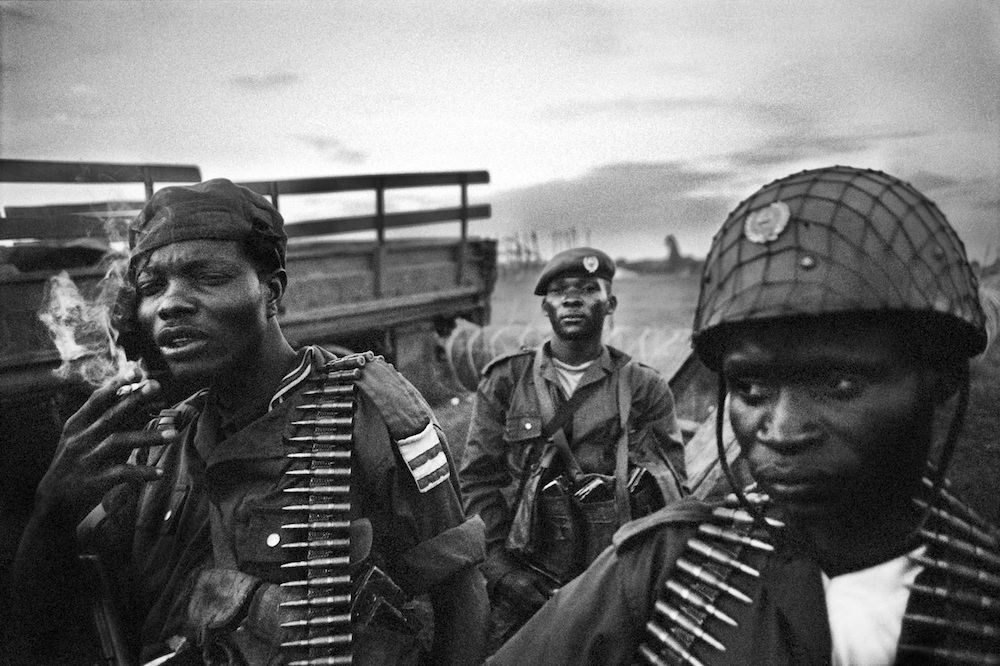 Members of the FARDC (Armed Forces of the DRC) in Kpandroma, in the Ituri region. The soldiers, being little ($20 a month) or not paid, still rely on looting a population weakened by years of war. 80% of the abuses in Ituri are committed by the soldiers. 2007.  Inquire about this image