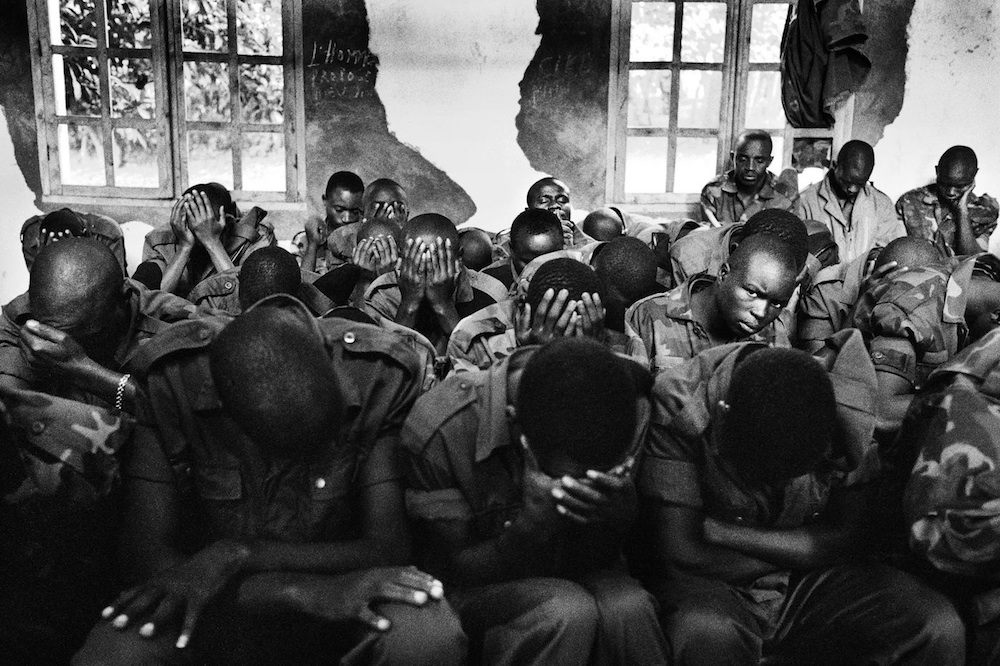 Morning prayer for the soldiers of the CNDP (National Congress for the Defense of the People) at the headquarter of General Laurent Nkunda, who is also a priest, in his stronghold of Kichanga, Masisi hills in North-Kivu. 2007.  Inquire about this image