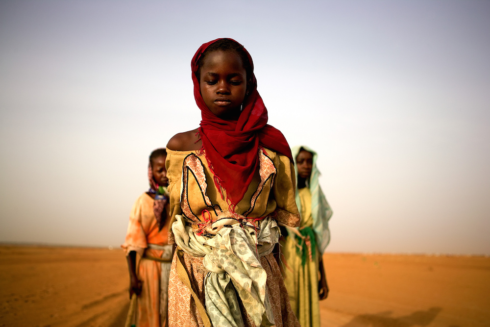 Young Darfuri girls leave a camp for internally displaced persons to gather firewood. Girls as young as 8 have been raped, attacked and killed trying to get wood. Darfur, Sudan, 2005  Inquire about this image