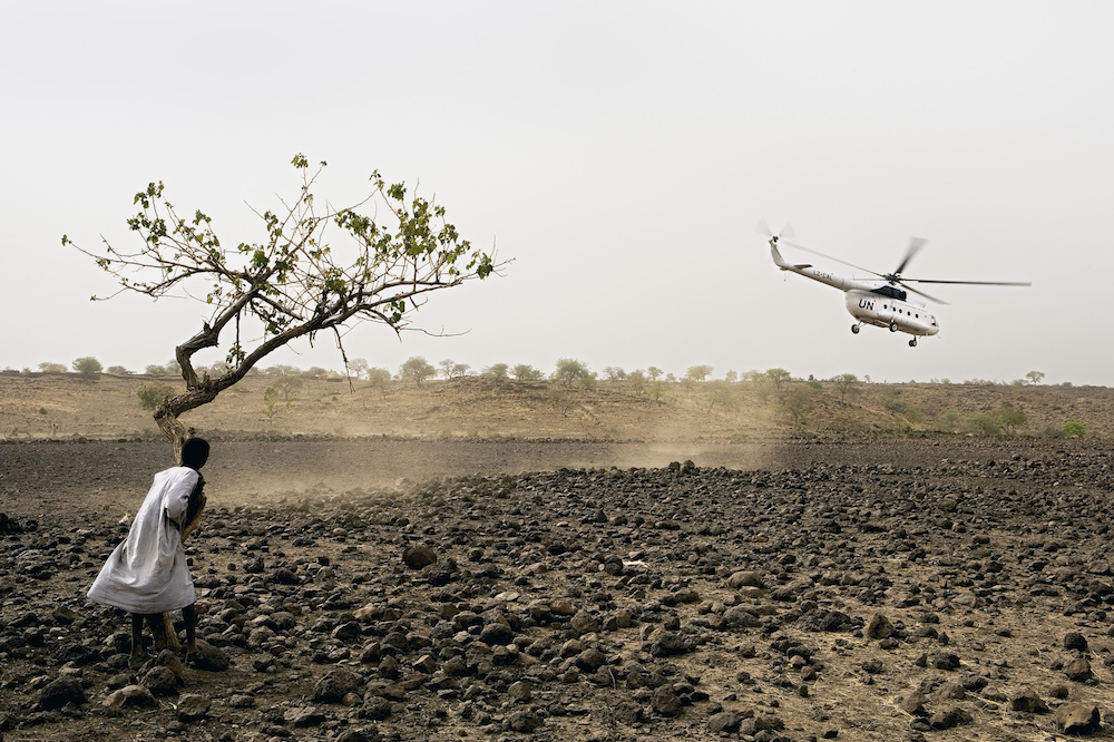 A United Nations helicopter is one of the few contacts between this area and the outside world in Darfur. Sudan, 2005  Inquire about this image