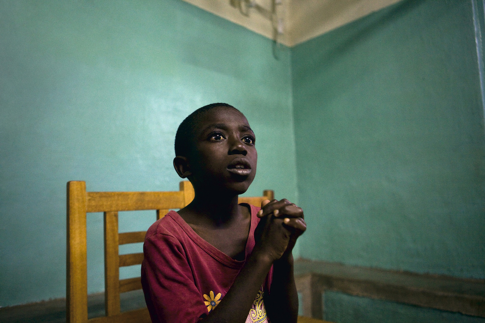 Ozias Kambale Pimo, 11, is told his parents are still alive and that he will be reunited with them soon by the ICRC. Democratic Republic of Congo, 2009   Inquire about this image