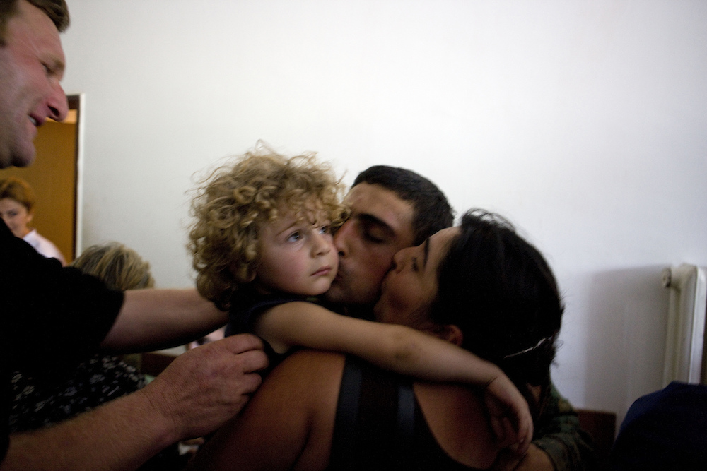 Georgian prisoners of war arrive at a hospital after being exchanged for Russian soldiers in Tbilisi, Georgia on Aug. 19, 2008. They were greeted by family members and friends.  Inquire about this image
