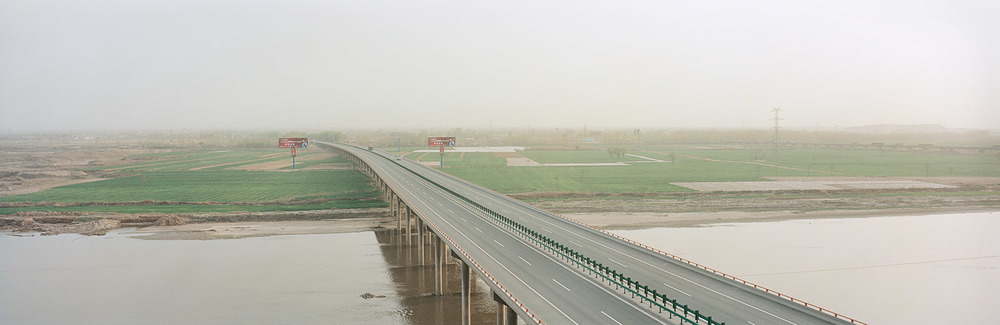 New highway, agricultural land and the Yellow River. Lanzhou, China. 2011.