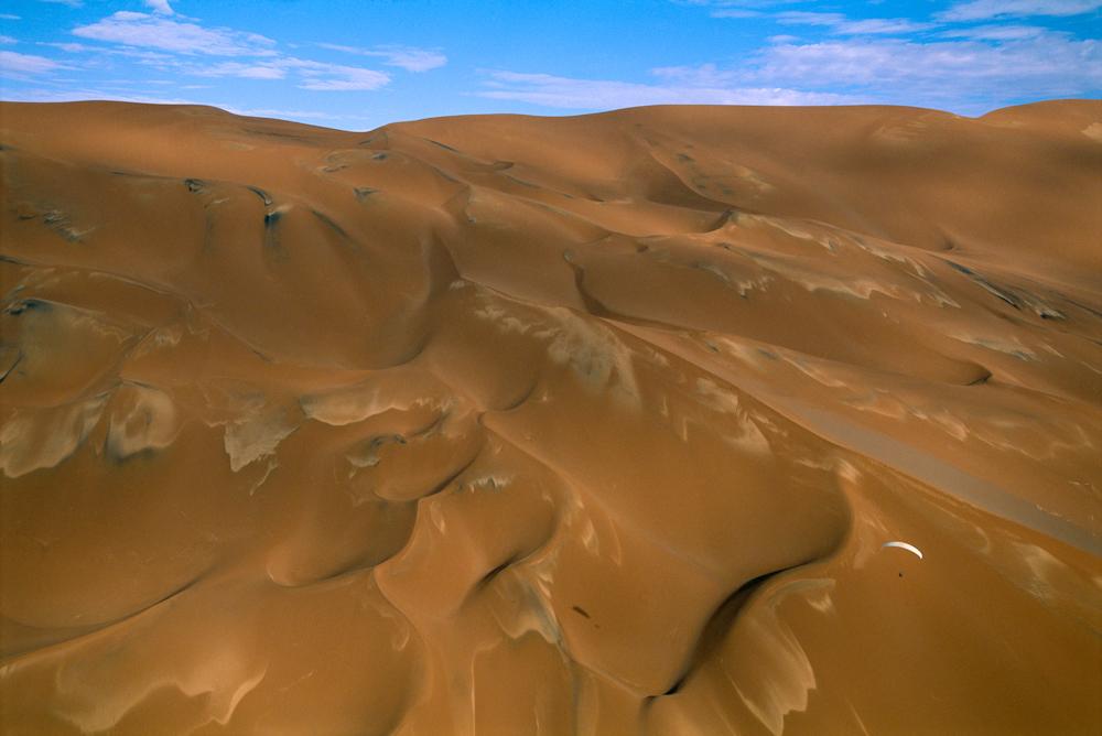 Paraglider over Mega Dunes, Dasht-e Lut, Iran.