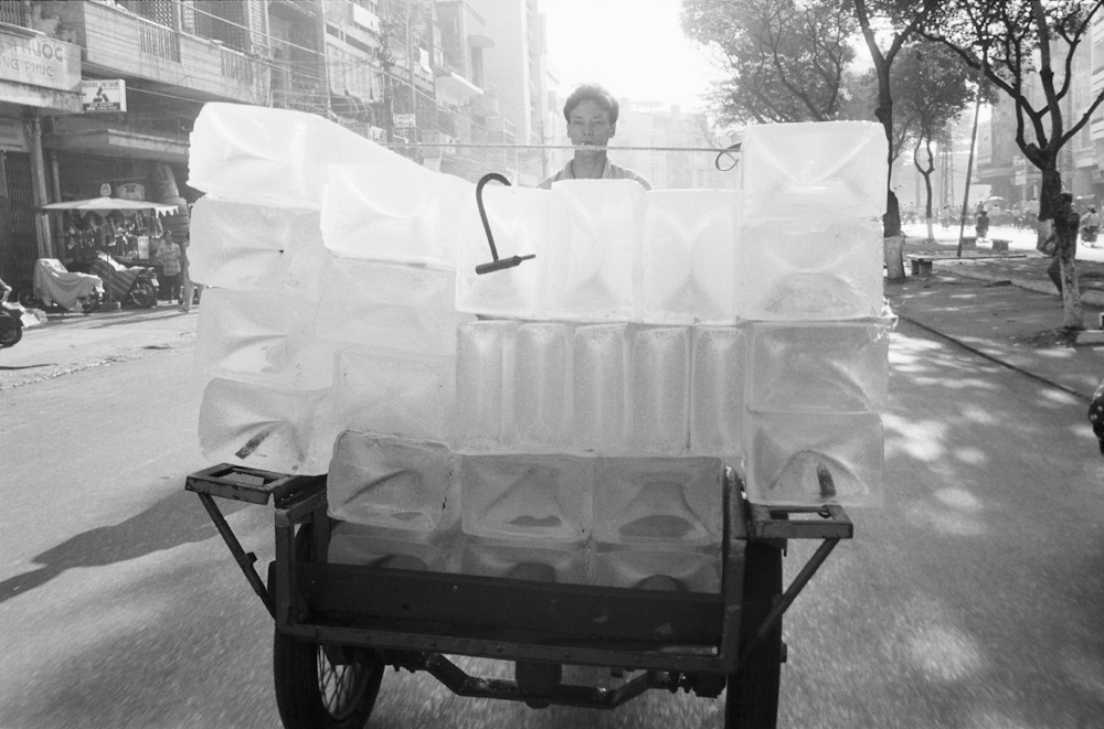 The iceman travels in a cyclo, or motorcycle cart. 1994.   Inquire about this image